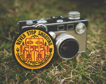 """Never Stop Shooting - 3"""" Embroidered Patch"""