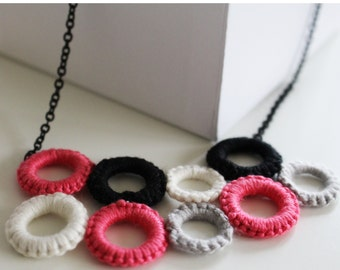 Colourful tatted hoop necklace.
