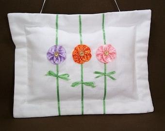 Pocket pillow, white linen door hanger pillow, hand beaded, multi colored ribbon flower embellishment, pocket on the back for treasure.