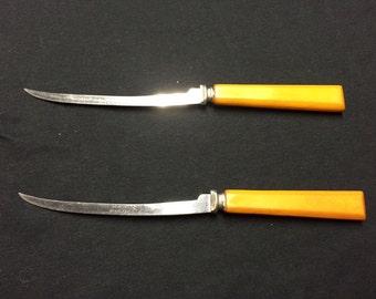 Vintage yellow Bakelite fish filet knives