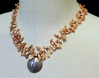 necklace with biwa pearls and hill tribe silver fish pendant