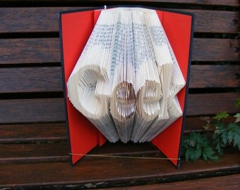 Folding book art, book sculpture, folded book art. Book Origami. Geek  folded into pages.