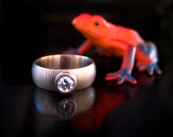 the dayton ring -- 7mm wide 18k palladium white gold with half carat diamond