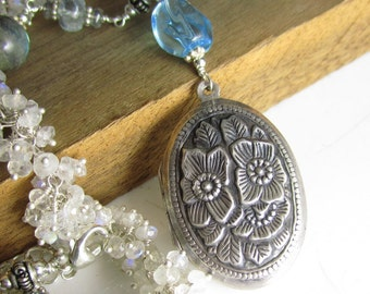 Clear Rain to Water the Flowers - Sterling Vintage Locket, Swiss Blue Topaz, and hand-linked chain with moonstone