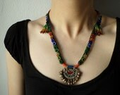 beaded statement necklace - with persimmon, red, burgundy, brown, indigo blue and green beaded flowers, cotton fibers and kuchi pendant