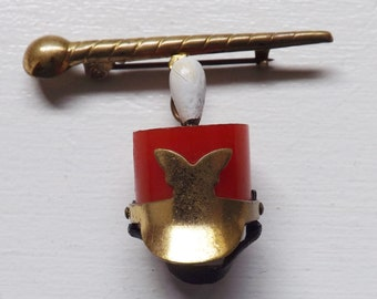 Vintage bakelite dangle brooch or pin majorette drum major hat and baton brass with painted glass plume tested