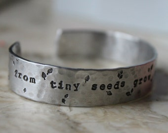 FREE SHIPPING. Handstamped Cuff Bracelet. From tiny seeds grow mighty trees. Teacher Babysitter Mom Gift. Silver Aluminum or Copper.