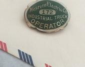vintage western electric co. badge