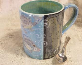 Mug With Striking Black And Neutrals, Blue Fish Mug