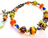 SALE, Bold Lampwork Glass Bracelet, Orange Cobalt Blue Olive Green, Dragonfly Leaf Charm, Fun Colorful Bracelet For Her, Ready To Ship