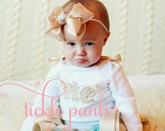 Please make a big fancy hairbow to match my sweet baby's birthday tutu!