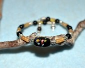 Black and gold glass seed bead memory wire bracelet, bangle, cuff, wrap