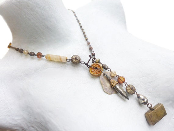 Light travels. Rustic Victorian tribal lariat in golden amber yellow.