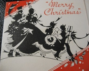 Vintage Art Deco Christmas Card With Silhouette Scene Showing Couple And Children Carrying Gifts