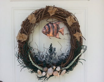 This is a hand made wreath useing natural materials copper and seashells