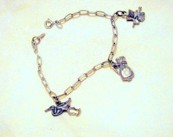 Sterling Silver vintage Charm Bracelet with three charms, blowout sale!