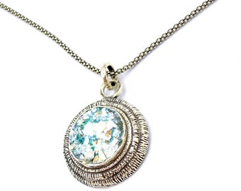 Silver pendant, round roman Glass with level silver metalwork