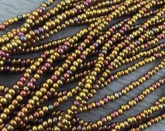 10/0 Czech Seed Beads 12 Strand Hank, Gold Iris