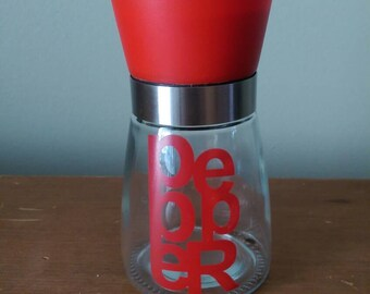Red Plastic and Glass Pepper Grinder