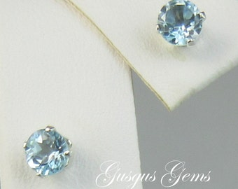 Sky Blue Topaz 4mm .65ctw Sterling Silver Stud Earrings