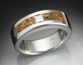 Man's diamond ring in platinum inlaid with gold laced quartz