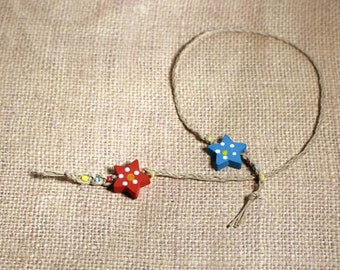 Macrame hemp beaded bookmark with blue and red wooden stars braided