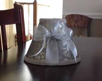 Elegant Chandelier Shades in a beautiful silver grey leopard print fabric.