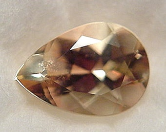 faceted Oregon Sunstone ................  10 x 7 x 5 mm  ..............       a847