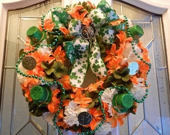 St. Patricks Day Wreath, Green Shamrocks, Carnations, Orange tiger lilies,coins, Hats, bead garland