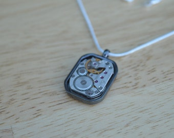 Large rectangular watch movement necklace with gunmetal surround