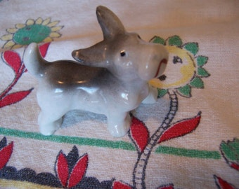 little grey and white doggy figurine