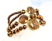 LP 1244  Three stretchy Bracelets Of Copper Colored Hematine With Brown And Gold  Rutilated Quartz