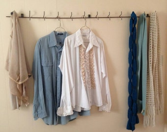 Scraping to upcycle a rustic, industrial coatrack