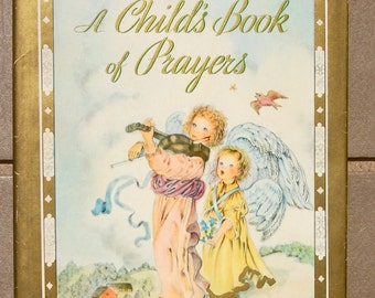 1941 edition of A Childs Book of Prayers with dust jacket selected by Louise Raymond illustrated by Masha. Random House