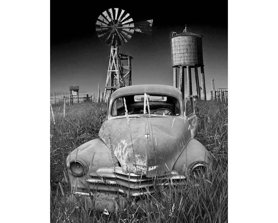 Abandoned Vintage Auto on a Prairie Farm with Windmill and