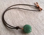 Pendant Necklace- Jade Good Luck Symbol on Leather Cord with Copper Clasp
