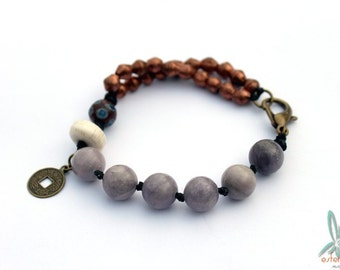 Chi - spiritual, ethnic bracelet in copper and soft purple with gemstones, mala and trade beads