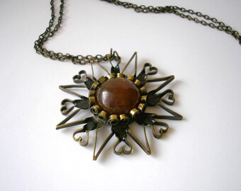 Vintage USSR Soviet handmade brass sun pattern necklace with Baltic amber