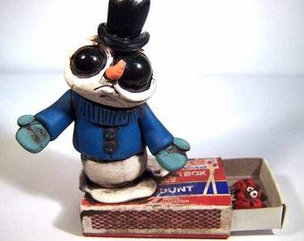 Wtf! Melting Snowman Stevie on a Matchbox with the hot head matches desk buddy polymer clay original covington creation art