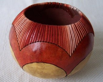 Small natural gourd bowl, wood burned details, rust, stitched. 1753.