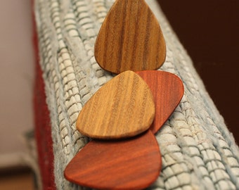 4 wood guitar picks.  Redheart &  Lignum Vitae  wooden guitar picks