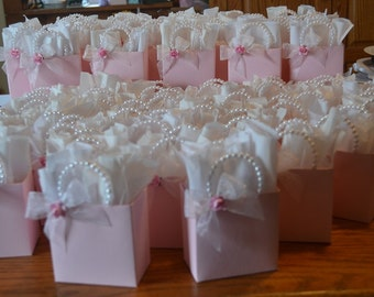 PInk party favor bag with beaded handles