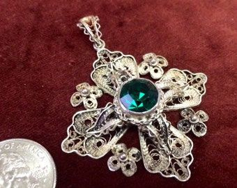 Ornate filigree Jerusalem cross pendant with synthetic emerald stone