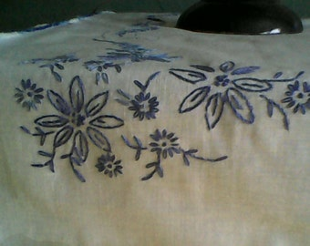 Handmade tablecloth with blue hand embroidery