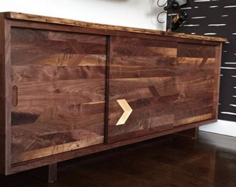 Walnut credenza with figured sliding doors and inlays.