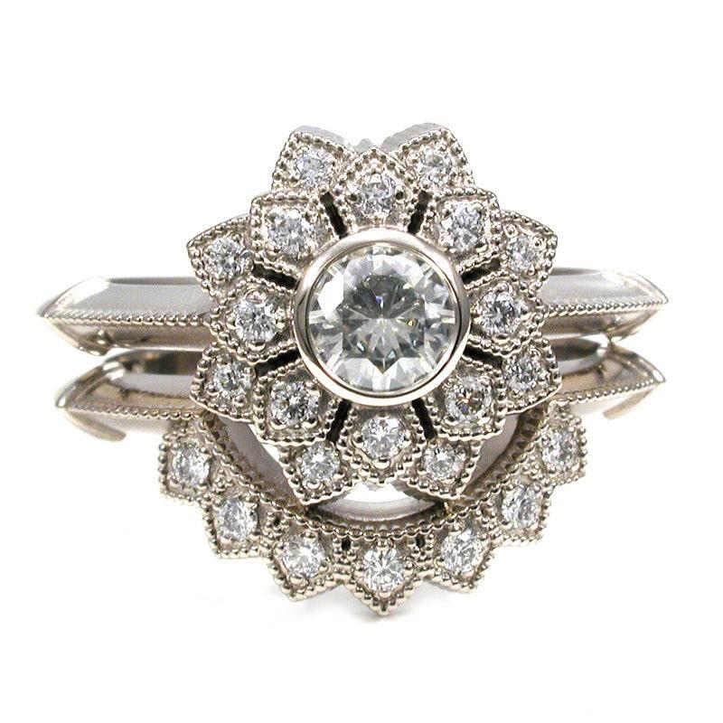 moissanite and palladium white gold engagement ring