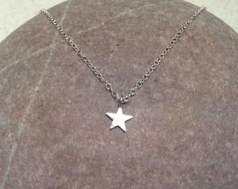 Sold Estrellita - tiny sterling silver star necklace