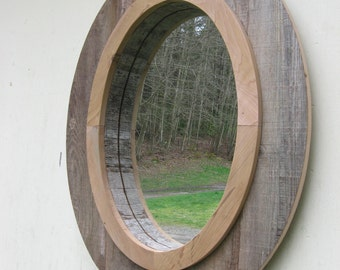wood oval wall mirror with decorative compass point