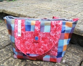 Brightly coloured, red, blue, Wipe Clean Hand Bag with Pockets & two Straps, lined, zipped