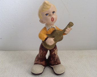 Vintage Chalkware Plaster Sculpture. Kitsch Blond Rockabilly figure.  Singing and playing guitar.